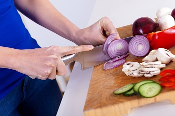 Person chopping onion